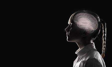 Young thoughtful girl of school age with closed eyes Stock Photo