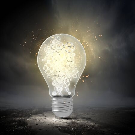 constructive: Conceptual image with light bulb and gears inside