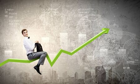 rise to the top: Young businessman riding graph arrow going up