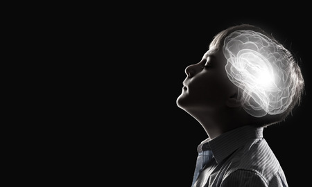 brain health: Young thoughtful boy of school age with closed eyes