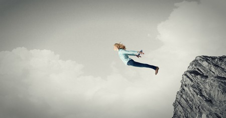 disoriented: Young girl on edge making step above gap