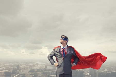 confidence: Young confident super businessman in mask and cape