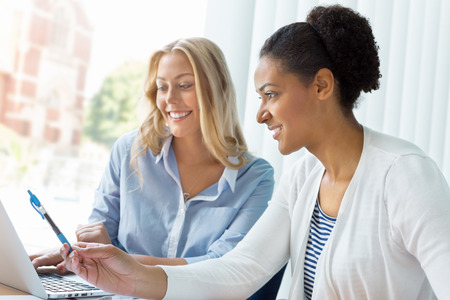 meeting together: Two women working together in office