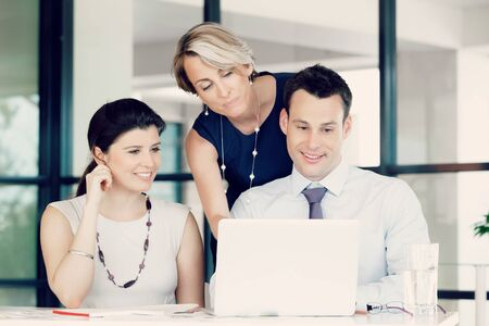 working: Team of business people working together Stock Photo