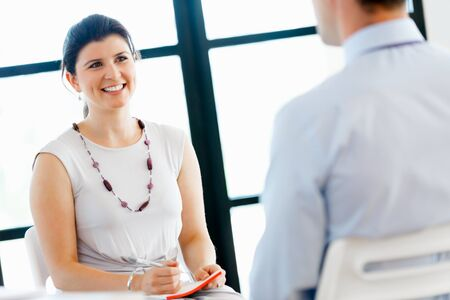 man and women: Business woman talking to her colleagues in office