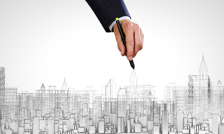 construction project: Close up of human hand drawing construction project Stock Photo