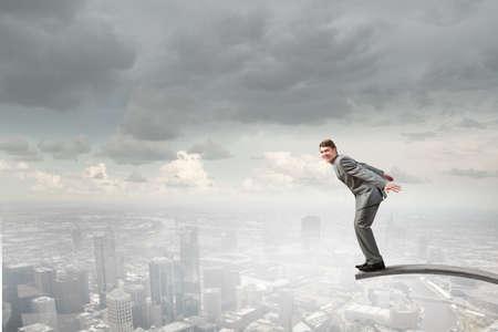 springboard: Joven empresario saltando de trampol�n en a lo profundo Foto de archivo