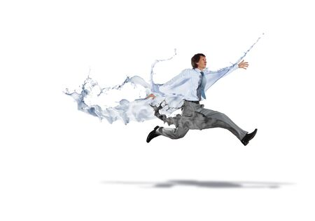 Funny young office worker running in a hurry photo
