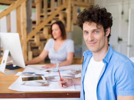 collegue: Businessman in office with his collegue at background Stock Photo