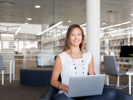Portrait of an attractive young woman using her laptop