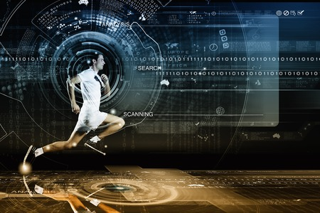 digital background: Young running man against digital media background Stock Photo
