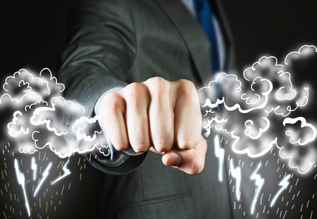 grasping: Close up of businessman grasping lightning in hand Stock Photo
