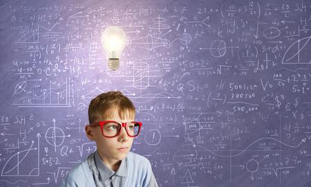 discover: Boy of school age in glasses. Idea concept