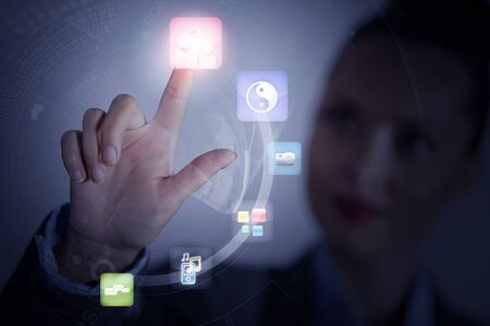 Close up of businesswoman touching icon of media screen photo