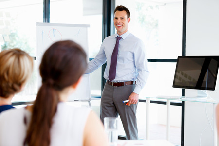 Businessman doing a presentaion in front of his collegues