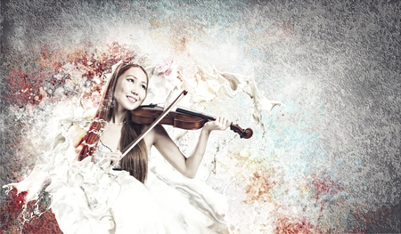 Young pretty asian woman playing violin. Young talent photo
