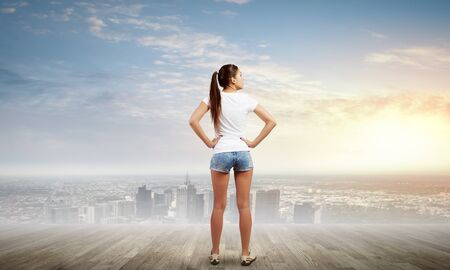 denim shorts: Rear view of young girl in denim shorts