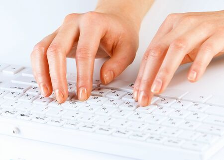 inputting: Close up of female hands typing on keyboard Stock Photo