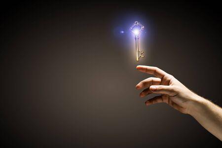 thumb keys: Close up of human hand touching key