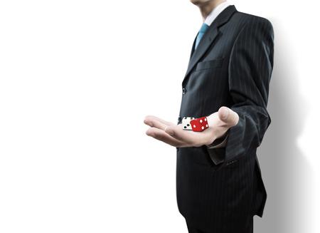 gambling: Close up of businessman throwing dice. Gambling concept Stock Photo