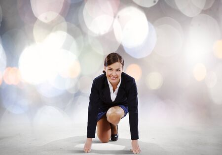Young attractive businesswoman standing in start position Stock Photo