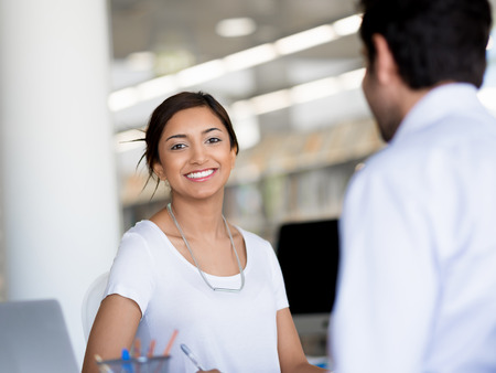 collegue: Young business woman having conversation with her collegue Stock Photo