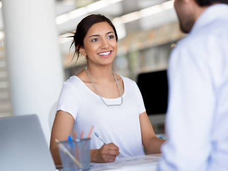 professional portrait: Young business woman having conversation with her collegue Stock Photo