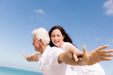 Couple having fun on the beach photo
