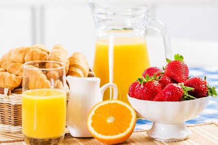 fruit juices: Breakfast with assortment of pastries, coffees and fresh strawberries