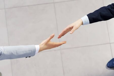 business deal: Close up of business handshake between two colleagues Stock Photo