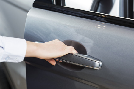 opening up: Close up of human hand opening door of car Stock Photo