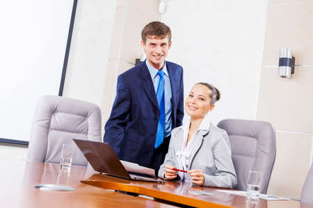 Accountant: Young businessman showing lady boss business documents