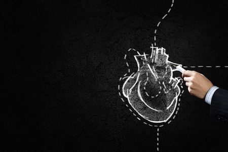human heart: Hand drawing human heart with chalk on black