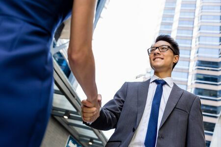 colleague: Businessman meeting his colleague outdoors