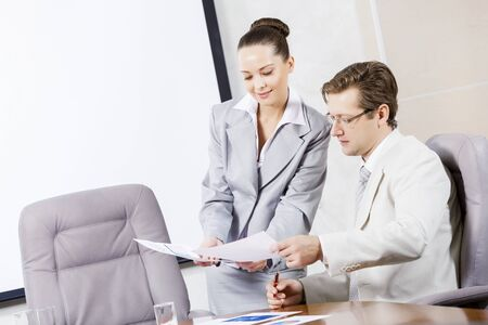 secretary woman: Young attractive secretary showing boss business documents Stock Photo