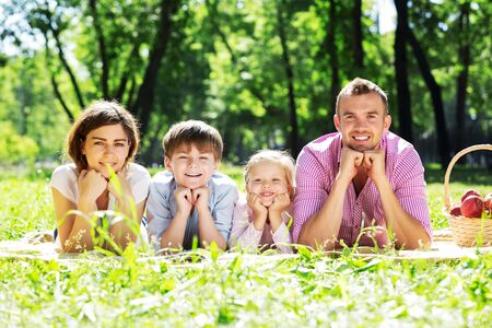 family portrait: Happy family having weekend in summer park