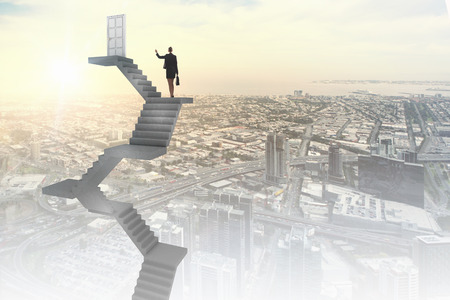 climb job ladder: Businesswoman walking up staircase to door in sky Stock Photo