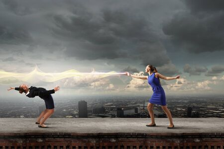 evade: Young businesswoman benting back to evade from light Stock Photo