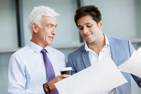 Two businessman in office having discussion Stock Photo
