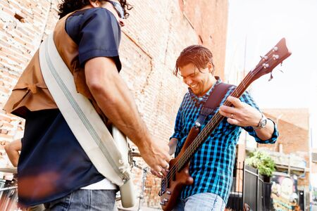 young musician: Band of musicians playing in the street Stock Photo