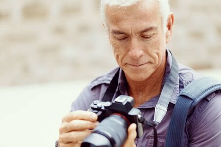 old street: Senior man with camera in city Stock Photo