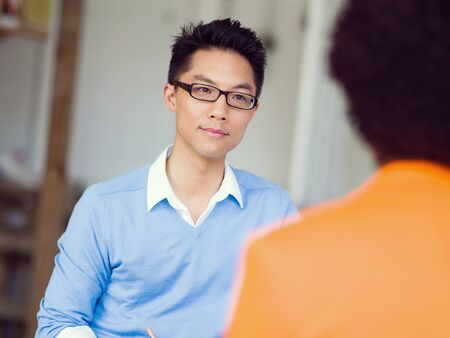 interview: Young candidate having an interview with his employer