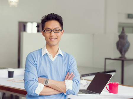 handsome young man: Portrait of young successful businessman in office Stock Photo