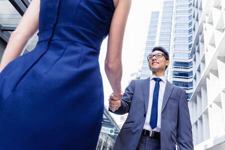 business buildings: Businessman meeting his colleague outdoors