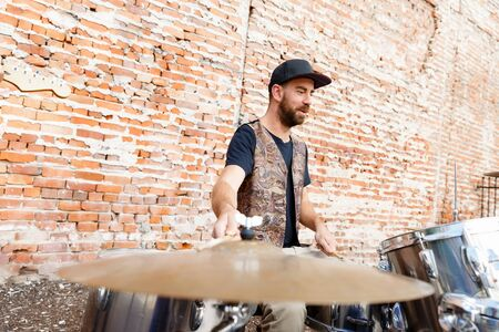 muscian: A street muscian playing drums