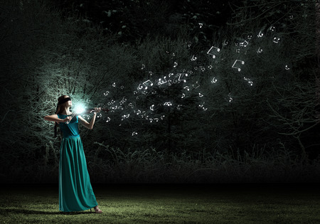 woman violin: Virtuoso violin female player in green dress
