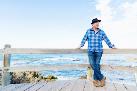 age 60: Portrait of an od man next to ocean