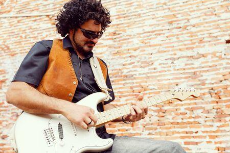busker: A street musician playing his guitar