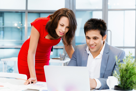 collegue: Two young business collegue working together in office Stock Photo