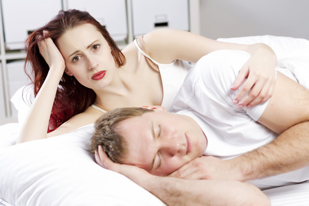 peacefully: Young couple sleeping peacefully in the bed